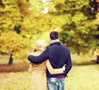 love, relationship, family and people concept - couple hugging in autumn park from back